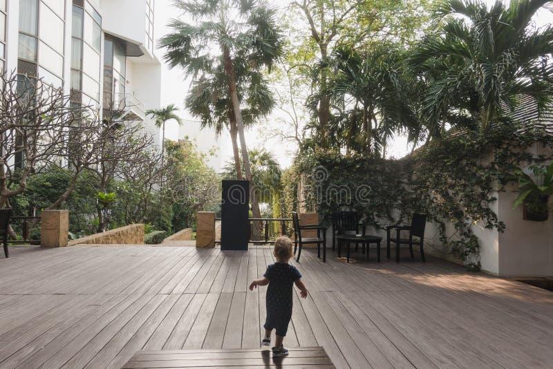 Little boy running on hotel terrace stock photography