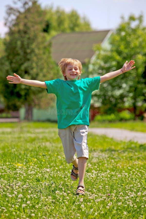 Little Boy Running In Park Stock Images