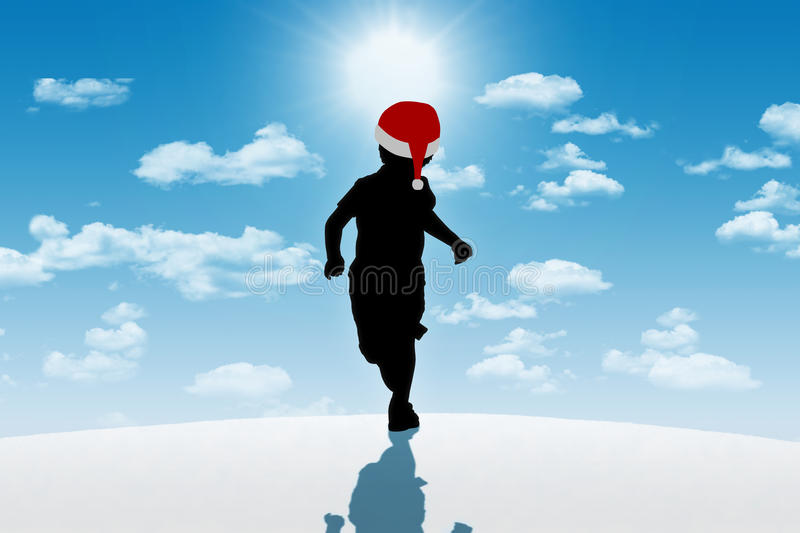 Little boy running in red hat on winter background royalty free stock image