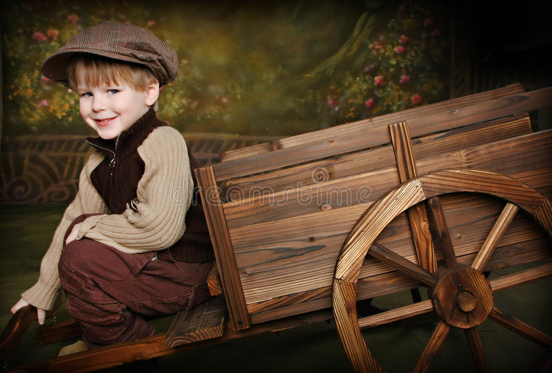 Download Little Boy With Rustic Wagon Stock Image - Image: 12909205