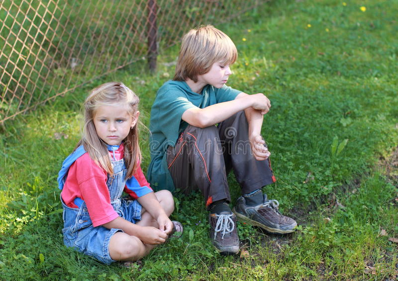 Little boy and sad girl stock photography