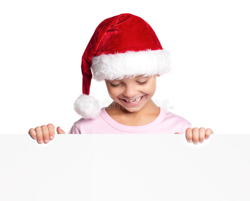 Little boy in Santa hat royalty free stock image