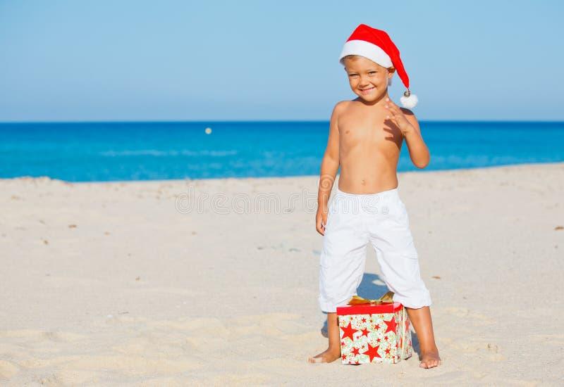 Little Boy In Santa Hat Stock Image