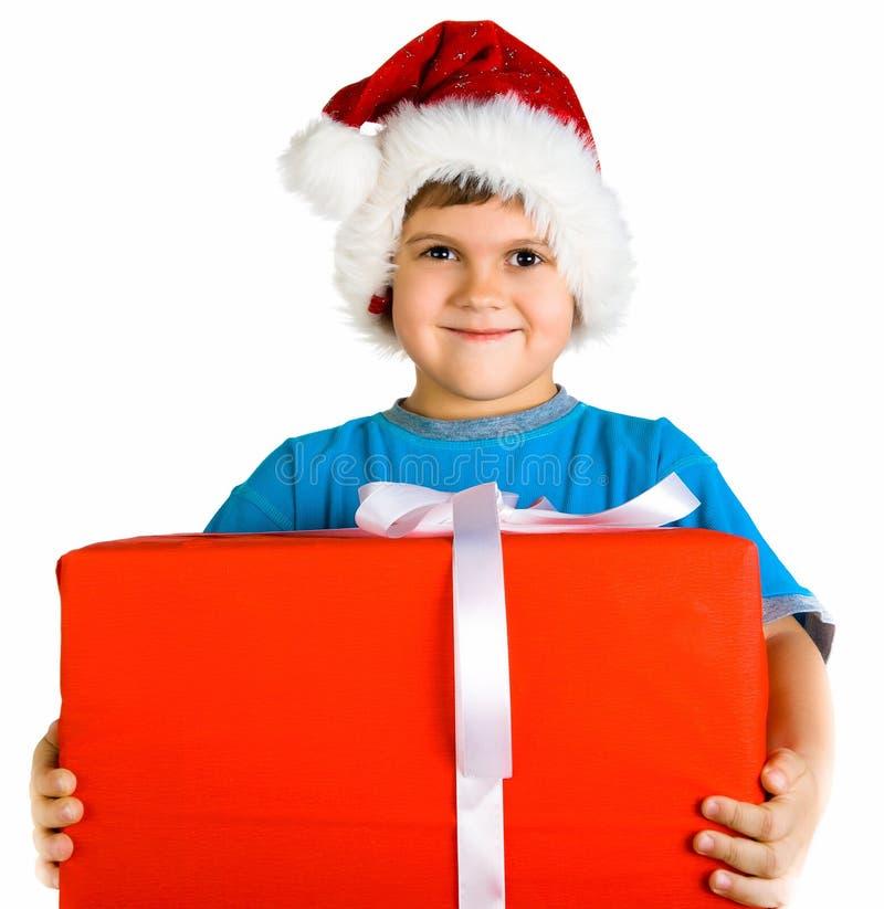 Little boy in santa hat with present