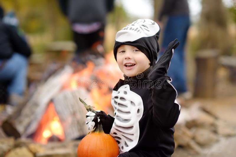 Little boy in scary skeleton costume at halloween celebrations party in forest royalty free stock photos