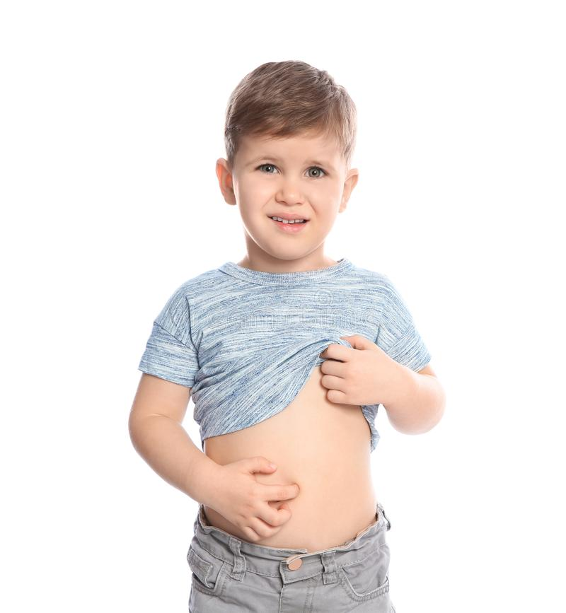 Little boy scratching belly on white background. Annoying itch stock photo