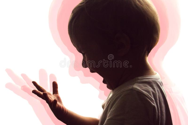 The little boy screams and cries. royalty free stock images