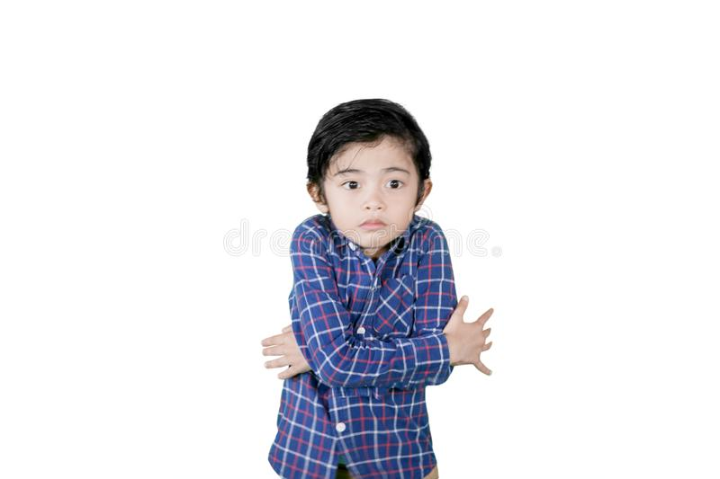Little boy shivering from cold on studio royalty free stock images