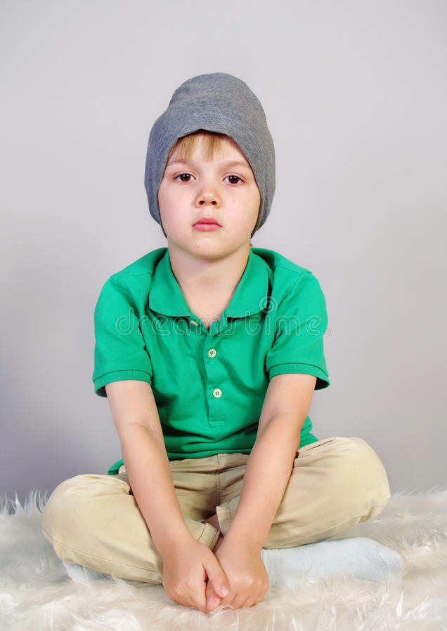 Little boy sits sad royalty free stock photography