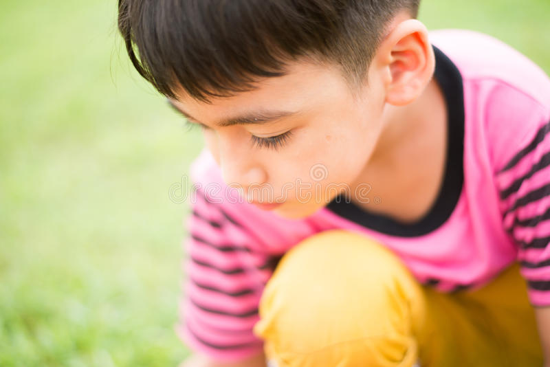 Little boy sitting alone close up solf stock images