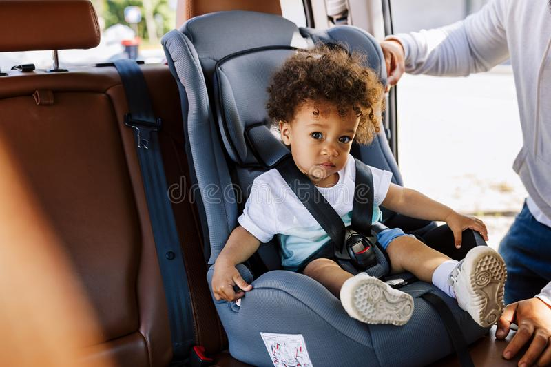 Little boy sitting on the baby seat in a car royalty free stock image