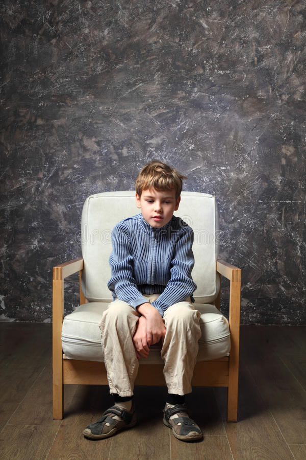 Little Boy Sitting in a Stock Footage Video (100% Royalty