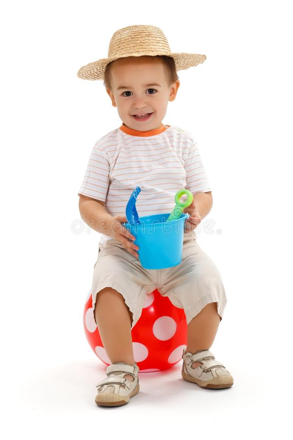 Little boy sitting on dotted ball stock images