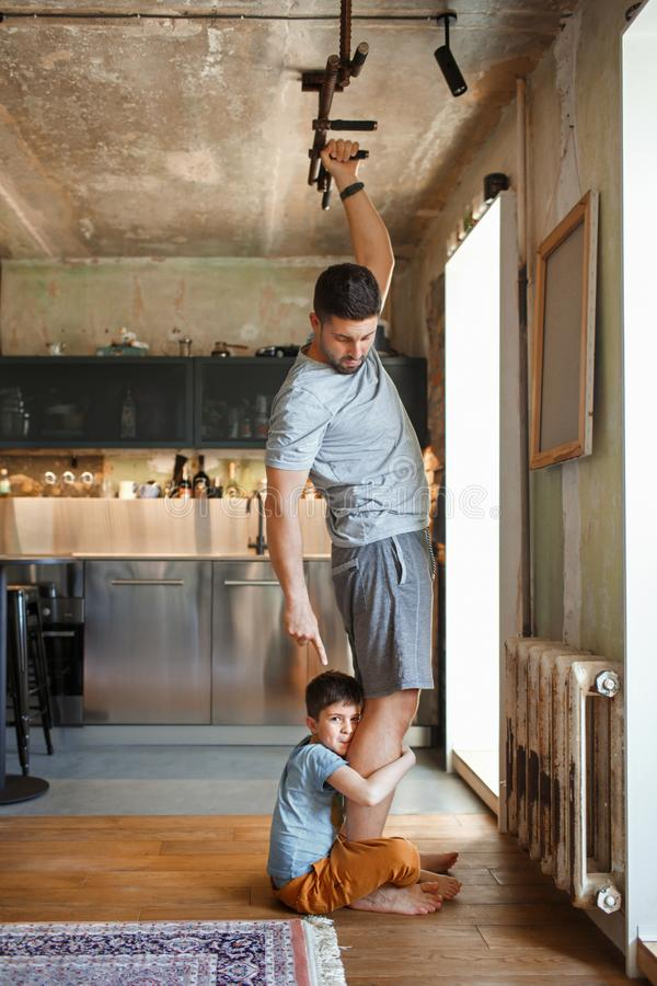 Dad and his little son play sports together royalty free stock images