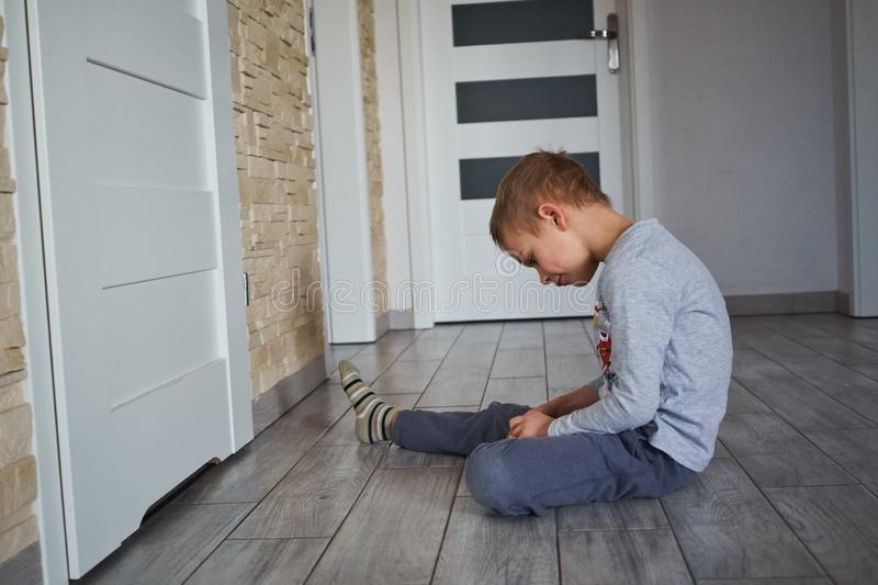 The boy is sitting on the floor royalty free stock image