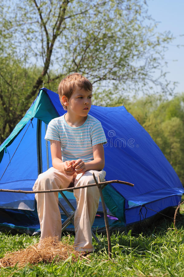 Download Little Boy Sitting Near Blue Tent On Nature Stock Image - Image of looking, nature: 18361643