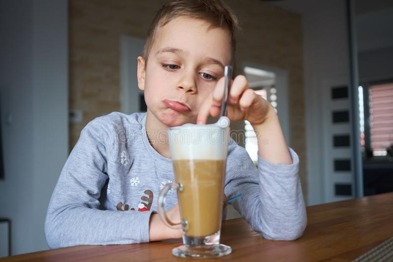 The little boy is looking at coffee stock photos