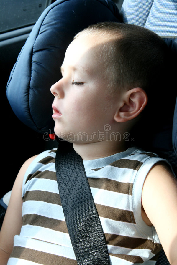Little boy sleeping in car stock photos
