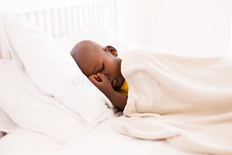Little boy sleeping. Peaceful african american little boy sleeping on bed stock photo
