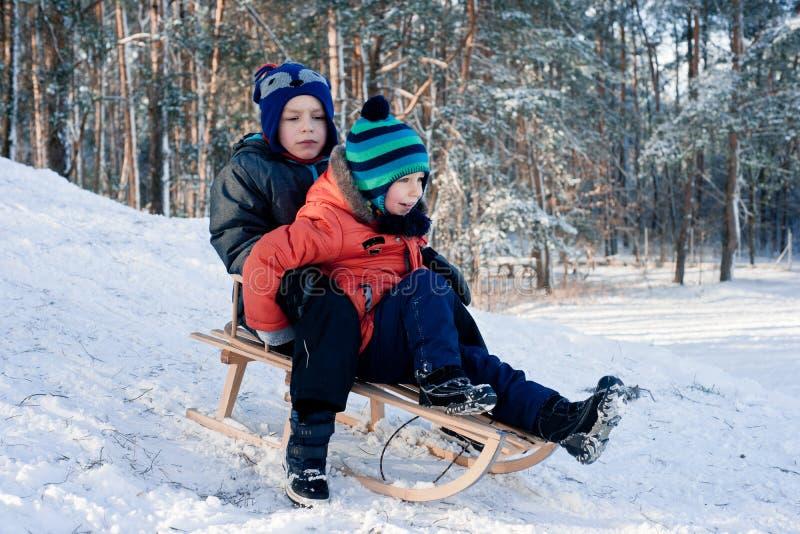 Little boy on sleigh stock photos