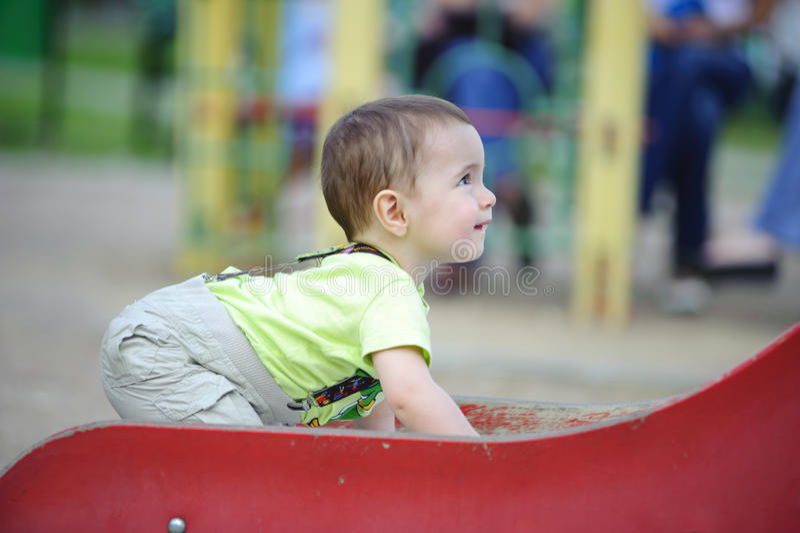 Little Boy On Slide Stock Images