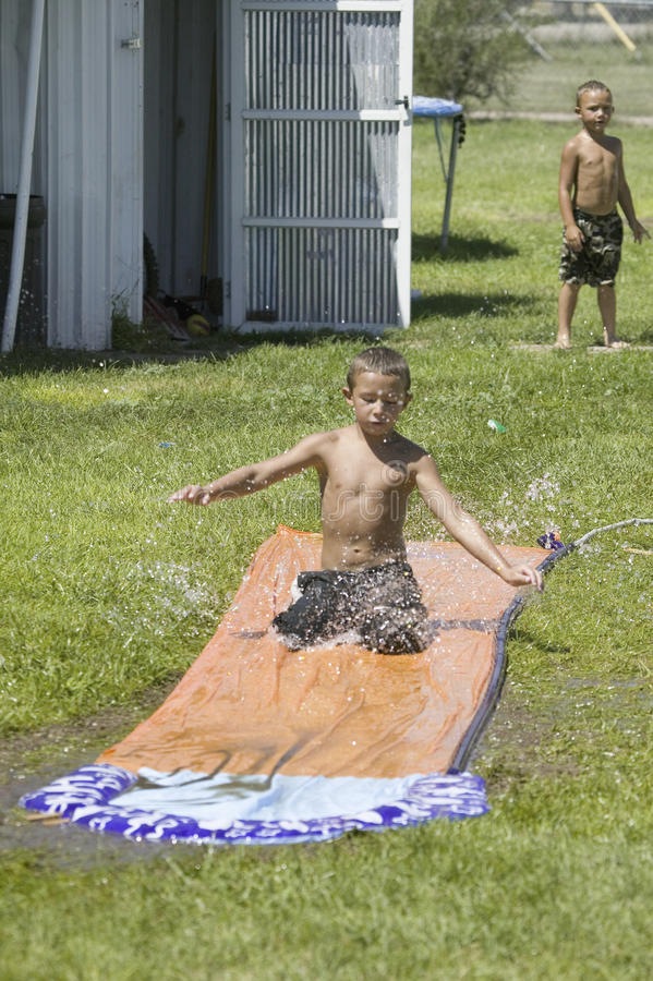 Download Little Boy Sliding On A Water Slide Editorial Image - Image: 27067000