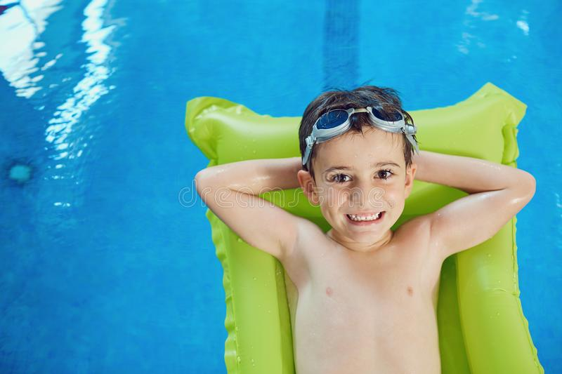Little boy smiling child smiling at swimming pool indoors royalty free stock photography