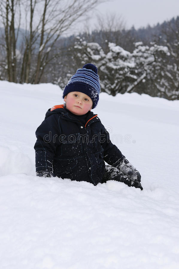 Download Little Boy On Snow Stock Photos - Image: 23140833