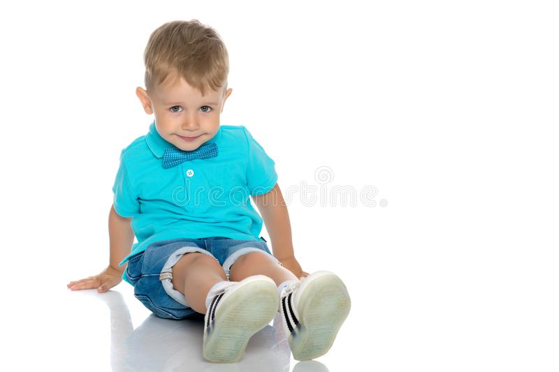 The little boy squatted down. royalty free stock images