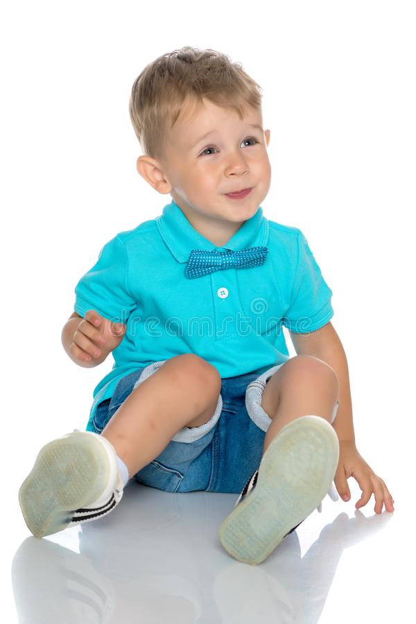 The little boy squatted down. royalty free stock photo