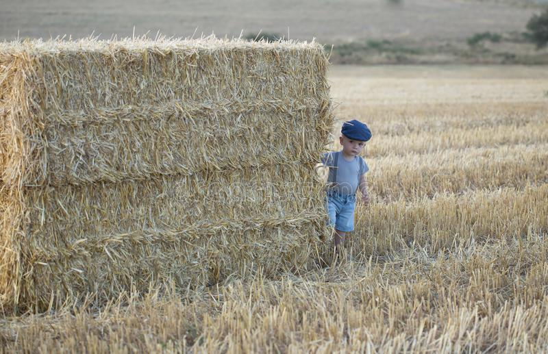 Little boy on a stack of hay stock photos