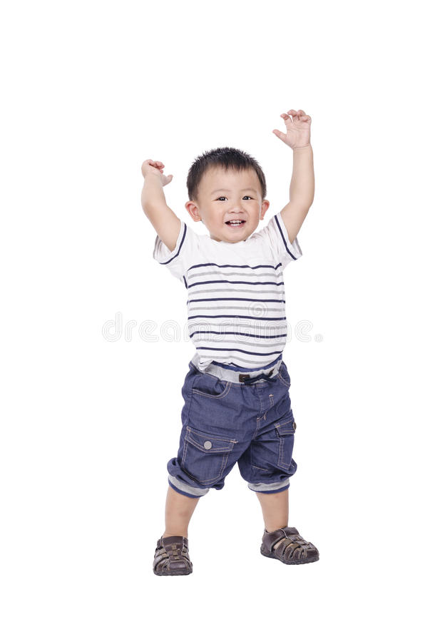 Little boy stand and raise hands up royalty free stock photo
