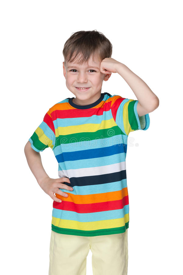Little boy stands against the white royalty free stock photos