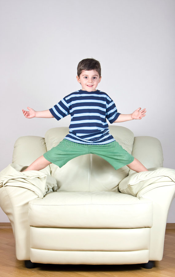 little boy in a striped T-shirt and green shorts stock images