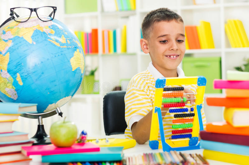 Little boy studying with abacus royalty free stock images
