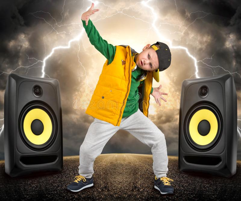 The little boy in the style of Hip-Hop . Children`s fashion.Cap and jacket. The Young Rapper.Cool Dancer. royalty free stock image