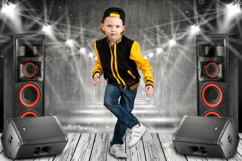 The little boy in the style of Hip-Hop . Children`s fashion.Cap and jacket. The Young Rapper.Cool rap dj royalty free stock photos