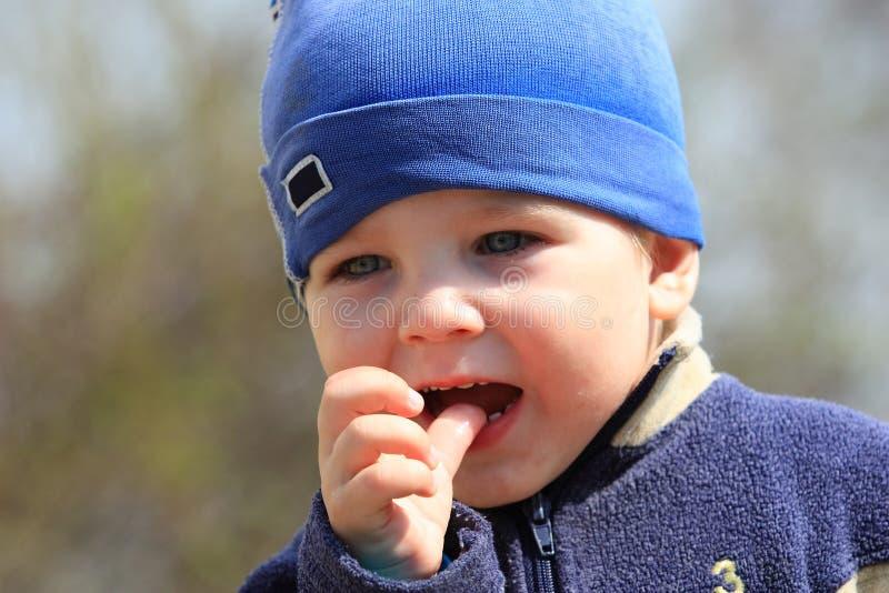 Little boy sucking his thumb royalty free stock photos