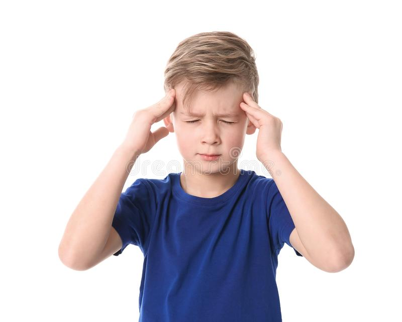 Little boy suffering from headache. On white background royalty free stock photos