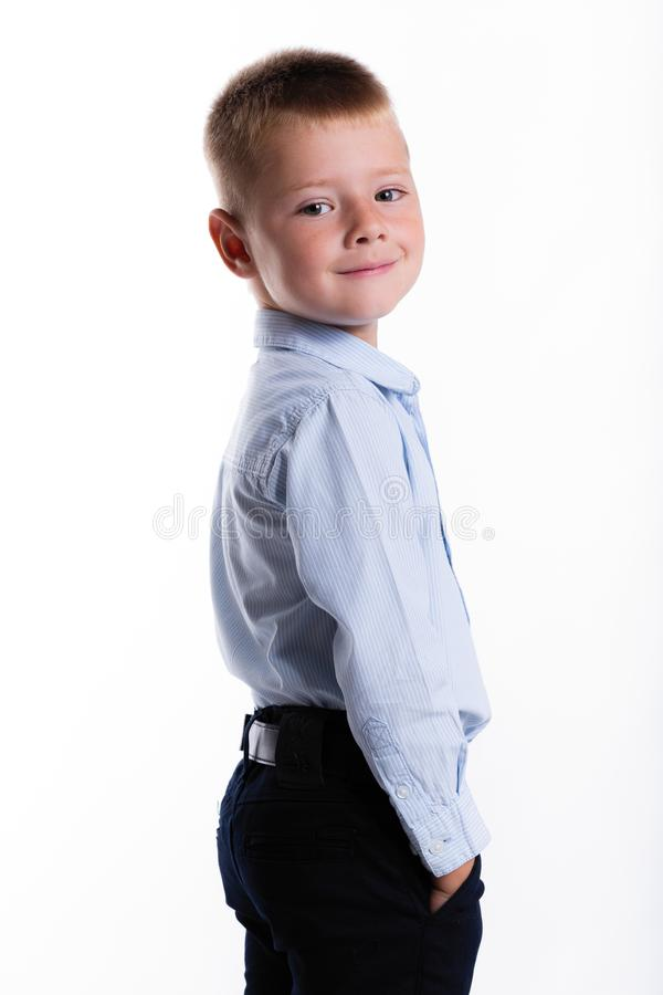 Little boy in suit. Children portrait. Back to school. Stylish m. An in fashionable suit shirt and pants with blue eyes royalty free stock image