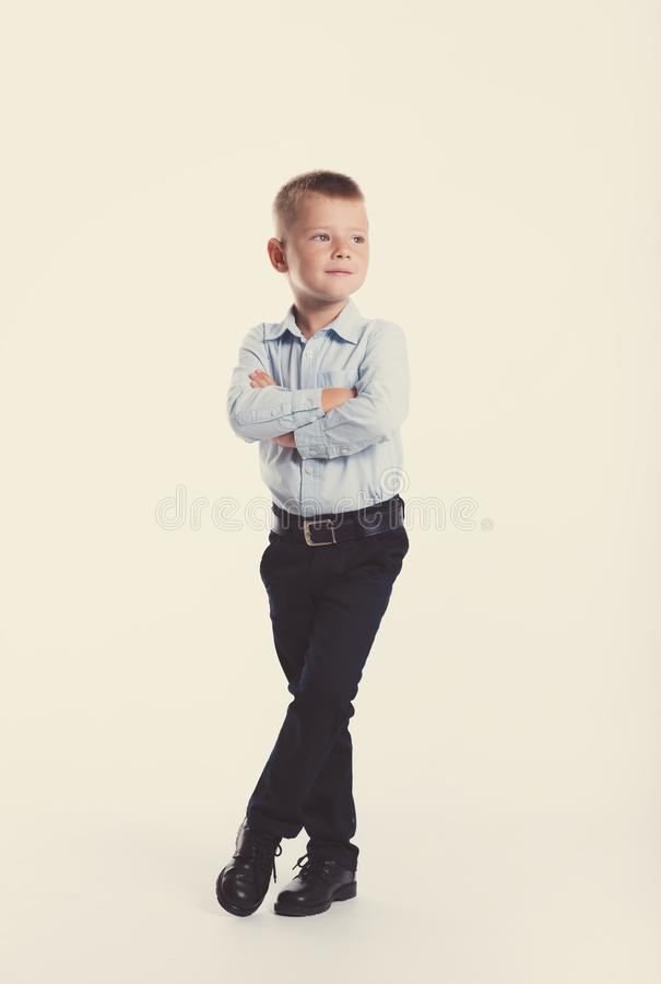 Little boy in suit. Children portrait. Back to school. Stylish man in fashionable suit shirt and pants with blue eyes stock photos