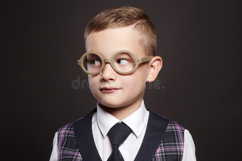 Little boy in suit and glasses stock images