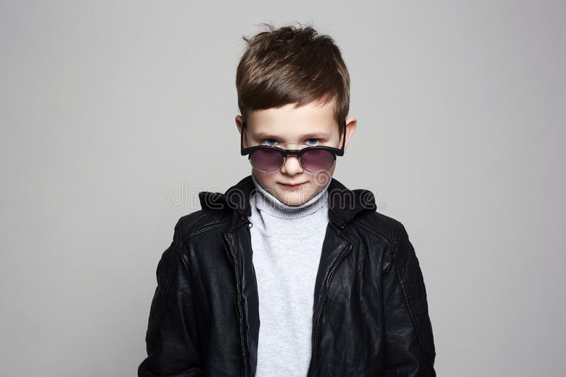 Little boy in sunglasses. stylish kid in leather stock image