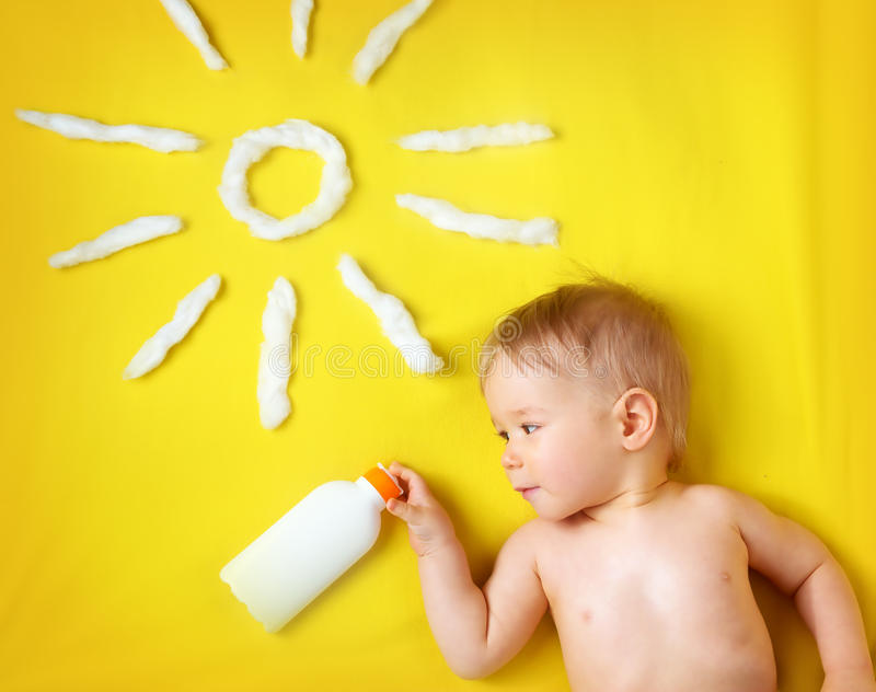 Little boy with sunglasses and sun shape stock photography