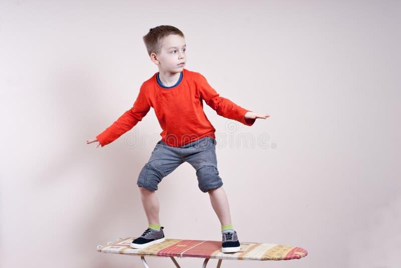 Little boy surfer stock photos