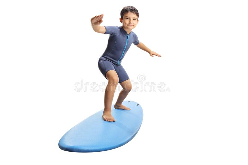 Little boy surfing on a surfboard royalty free stock images