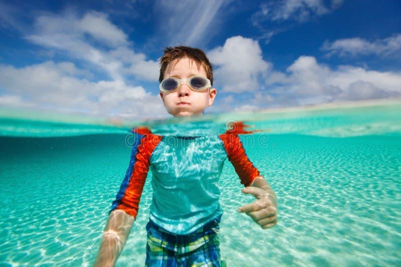 Little boy swimming in ocean royalty free stock photo