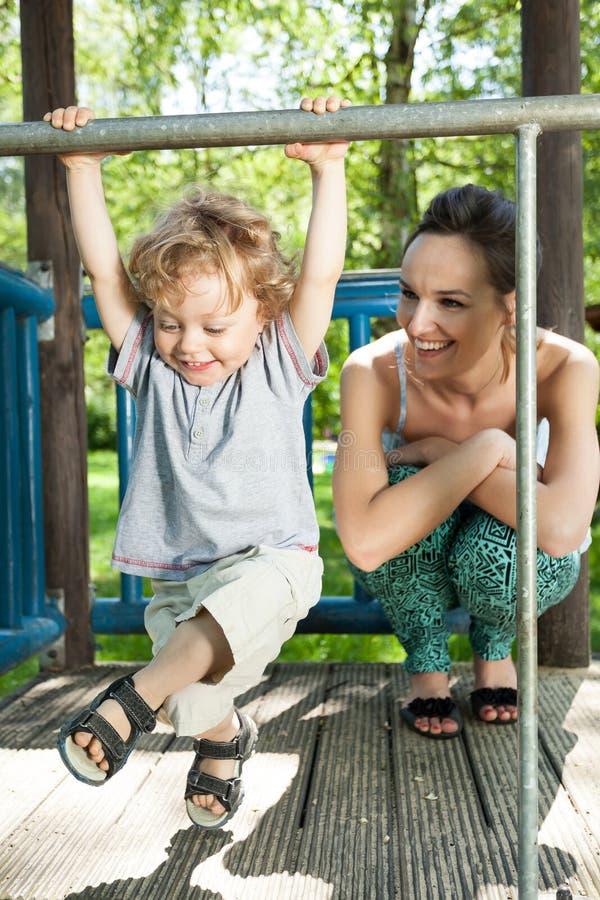 Free Little Boy Swinging On Monkey Bars Royalty Free Stock Image - 41883416