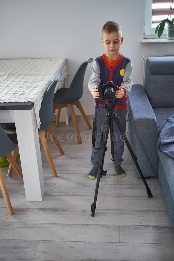 A little boy is taking pictures stock photography