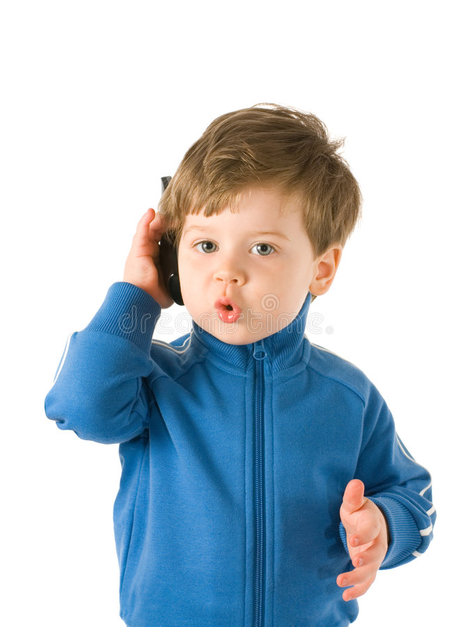 Little boy talking on the phone stock photography